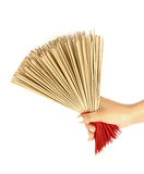 Hand holding incense Royalty Free Stock Photo
