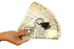 Hand holding Indian currency with house key Royalty Free Stock Photos