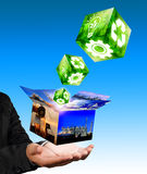 Hand holding with industrial box image. Businessman hand holding with industrial box image and green industrial cube concept royalty free stock photography