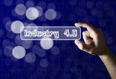 Hand holding industry 4.0 sign on blue background Royalty Free Stock Images