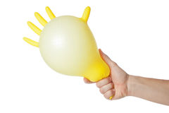 Hand holding inflated glove. Royalty Free Stock Photos