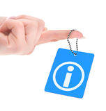 Hand holding information tag Stock Images