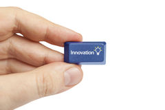 Hand holding innovation computer key. Stock Photos