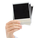 Hand holding  instant photo Royalty Free Stock Photo