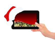 Hand holding ipad with christmas touch screen Royalty Free Stock Photos