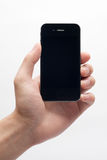 Hand holding iphone. In white background Royalty Free Stock Photography