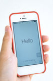 Hand holding iphone 5 with word Hello Stock Photos