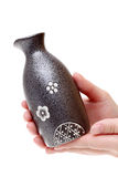 Hand holding japanese sake bottle Stock Photography