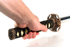 Hand holding a Japanese sword. (on white background Stock Photo