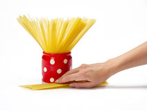 Hand holding jar with spaghetti inside Royalty Free Stock Images