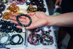 Hand holding jewelry at market Royalty Free Stock Photography