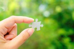 Hand holding Jigsaw stock photo