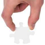Hand holding jigsaw piece Stock Photo