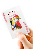 Hand holding a joker playing card Royalty Free Stock Images