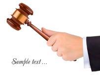 Hand holding judge gavel. Royalty Free Stock Photos