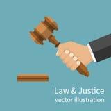 Hand holding judges gavel. Royalty Free Stock Photos