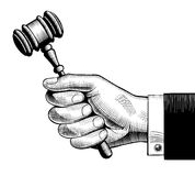 Hand holding judges gavel. Vintage engraving stylized drawing Stock Photos