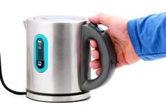 Hand holding a kettle Royalty Free Stock Photos