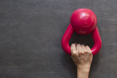 Hand holding kettlebell on a black background Stock Photography