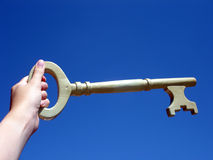 Hand holding a key. Key to success - conceptual image Royalty Free Stock Image