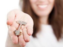 Hand holding key Stock Images