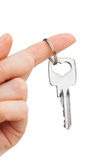 Hand holding key Royalty Free Stock Images