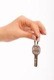 Hand holding key. Isolated on white background Stock Photo