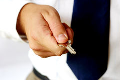 Hand holding key. Hand holding silver key Royalty Free Stock Photography