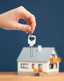 Hand, key and house Stock Photo