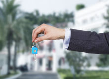 Hand holding key Stock Images