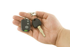 Hand holding key and car alarm system Stock Image