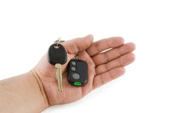 Hand holding key of car alarm system Stock Photography