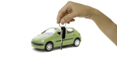 Hand holding a key and a car Royalty Free Stock Photo