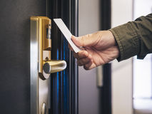 Hand Holding Key card Hotel room access. Safety system Royalty Free Stock Images