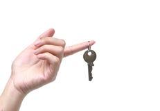 Hand holding a key stock photo