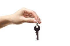 Hand holding a key stock images