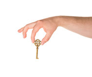 Hand holding a key isolated Royalty Free Stock Photos