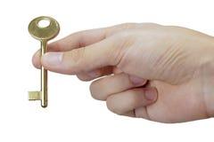 Hand holding key Royalty Free Stock Image