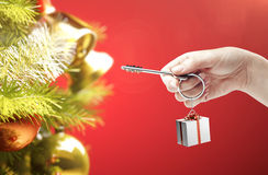 Hand holding key with a keychain in the shape of t Royalty Free Stock Photos