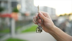 Hand Holding Key From A New House. HD, Close Up, Outdoors stock footage