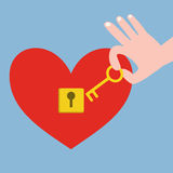Hand holding key and red heart with keyhole Royalty Free Stock Photography