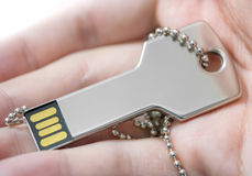 Hand holding a key shaped USB drive Stock Photography