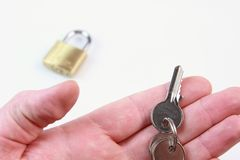 Hand holding key Royalty Free Stock Photos