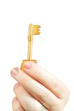 Hand holding a key of success Royalty Free Stock Images