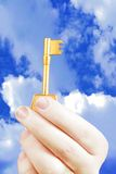Hand holding a key of success Stock Photo