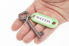 Hand holding Key to success Royalty Free Stock Images