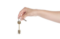 Hand holding a key on a white Royalty Free Stock Photography