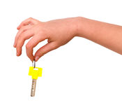 Hand Holding Key With Yellow Bow Royalty Free Stock Images