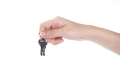 Hand holding keys. Hands and key isolated on white background Stock Photos