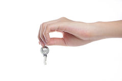 Hand holding keys. Hands and key isolated on white background Royalty Free Stock Photography